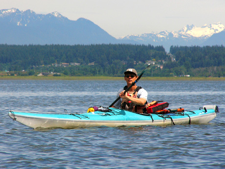 Photograph of owner Howard paddling his Kayak on the ocean