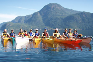 Photograph of a group of kayak students out on the water