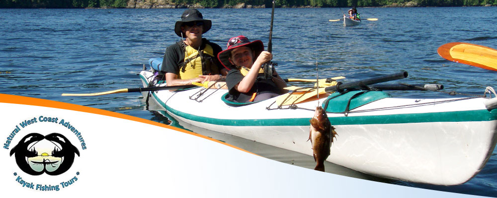 Man and a boy fishing in a kayak