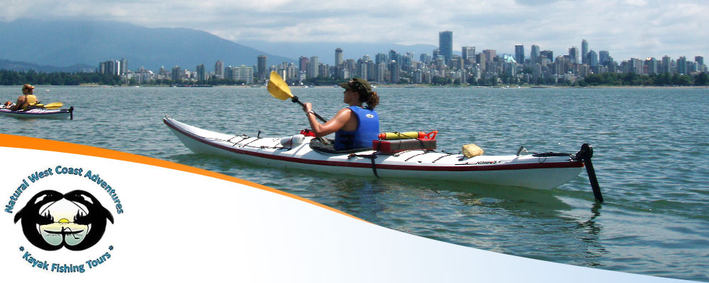 Woman paddling her kayak with city skyline in background