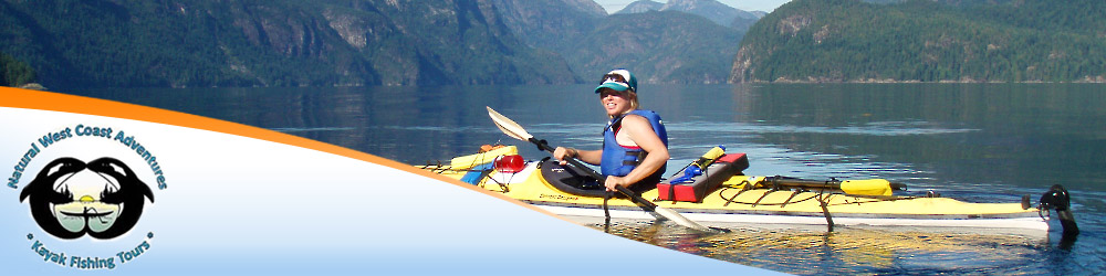 Photo of woman paddling her kayak with mountains in the background