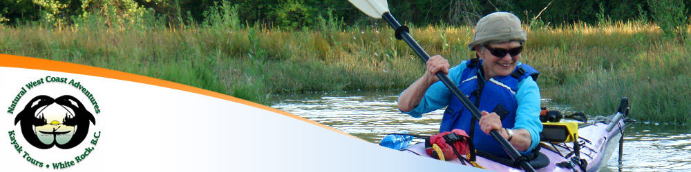 Photo of a smiling older woman taking a kayaking course