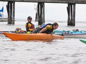 Photo of a kayaking student learning to capsize his kayak