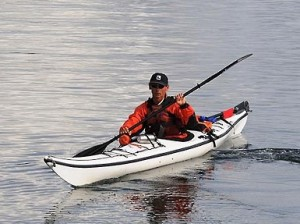 Photo of a kayak instructor floating in his kayak